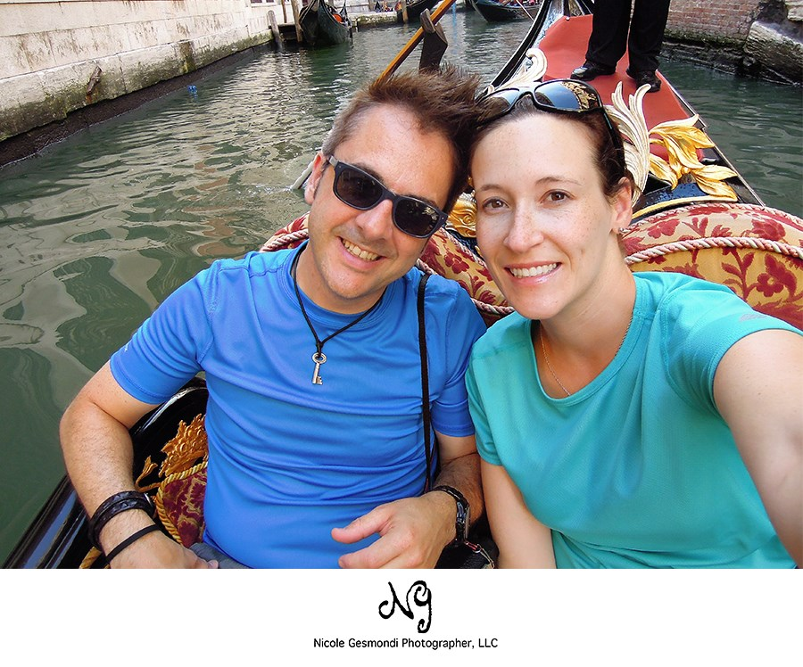 Newlyweds on a gondola ride in Venice, Italy