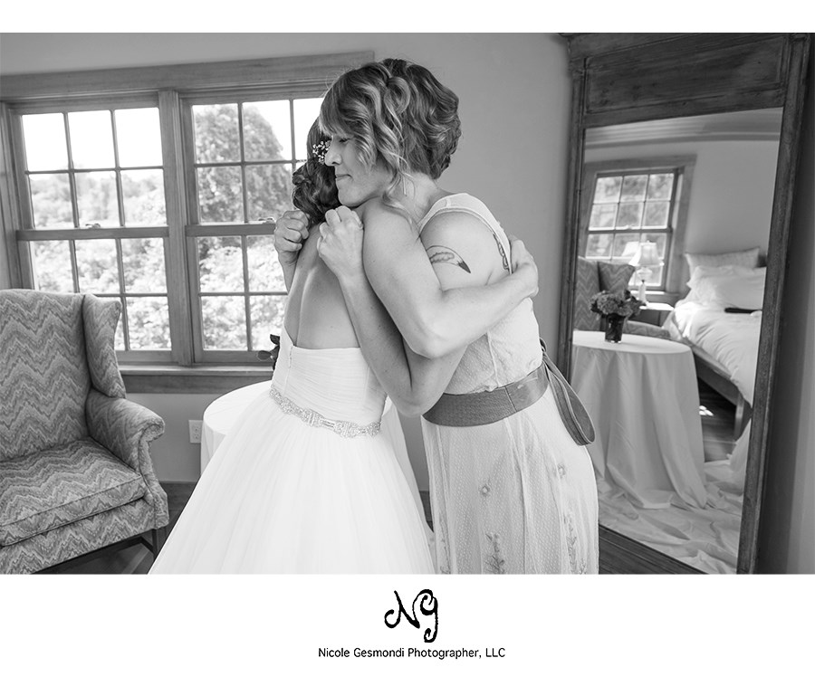 black and white photo of a bride hugging her sister