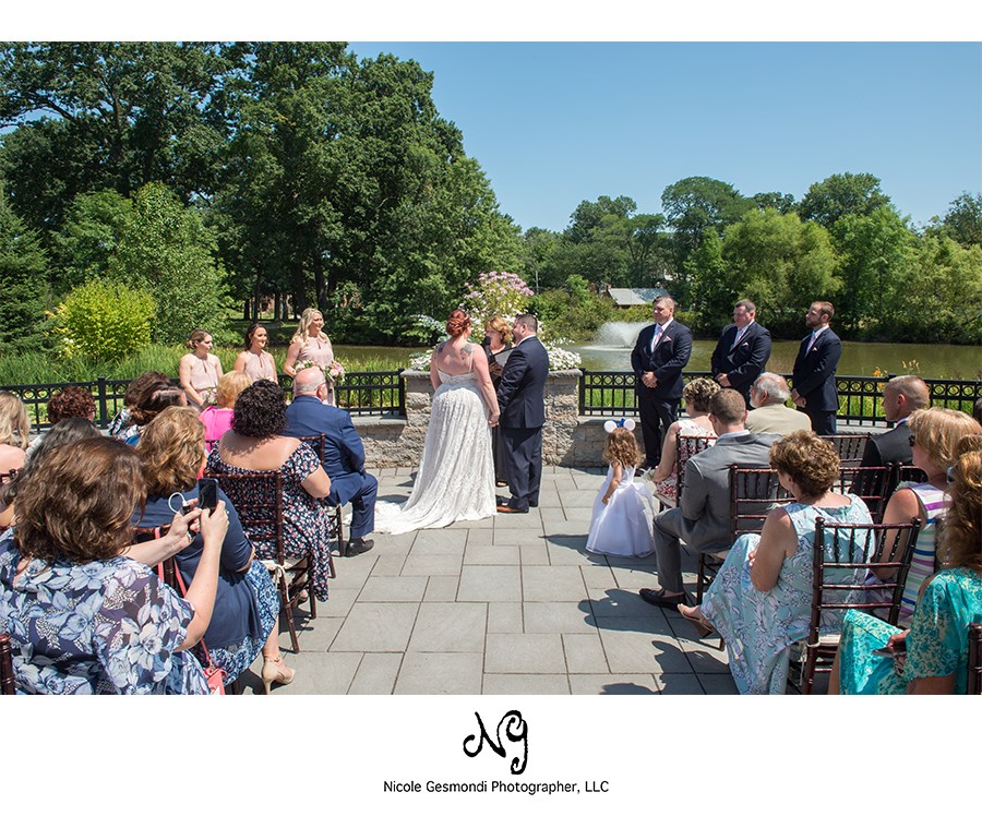 small wedding ceremony on patio at the Pond House in West Hartford, CT