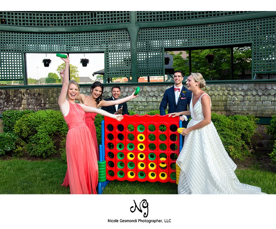 bride and wedding party playing giant Jenga at Tennis Hall of Fame in Newport RI