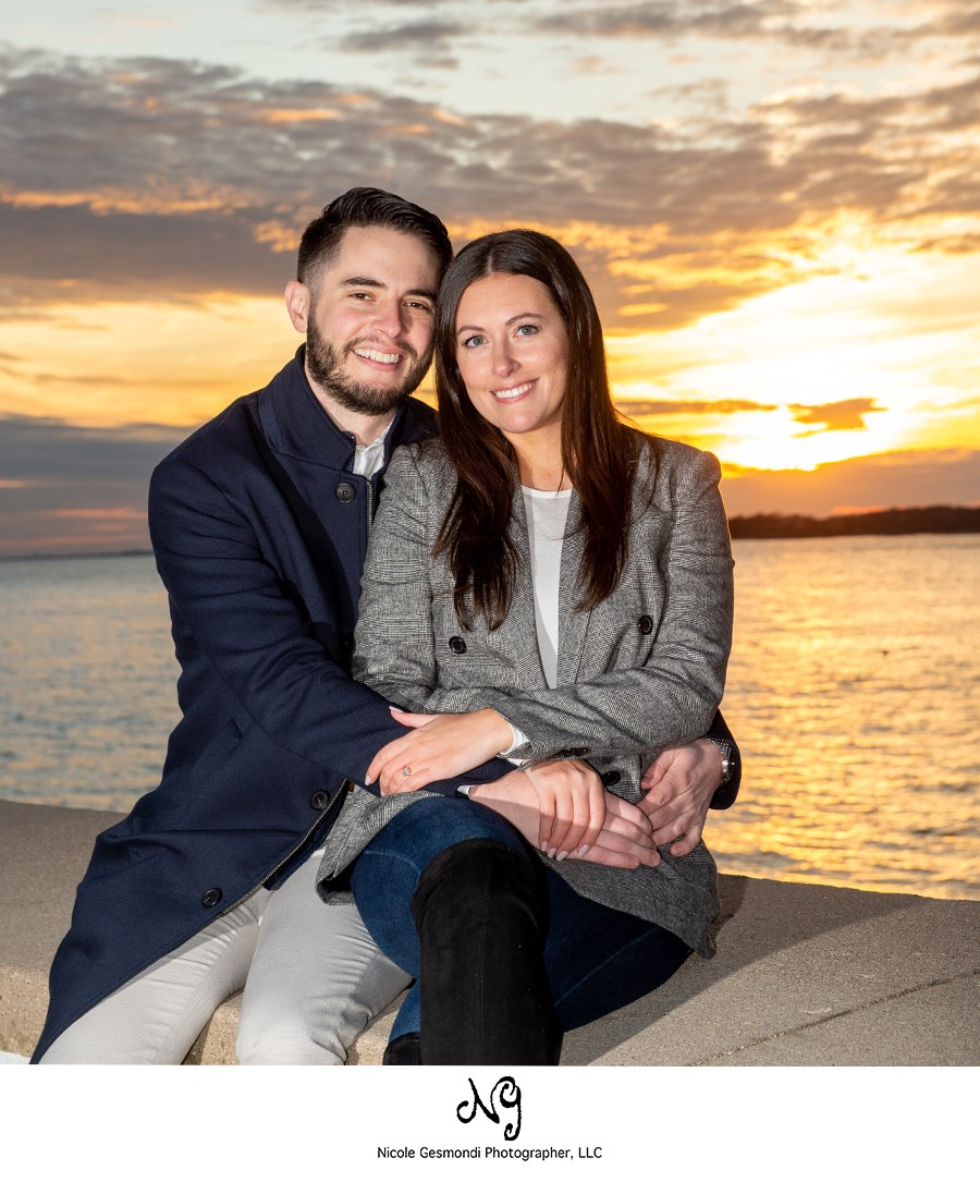 Photo of newly engaged couple with sunset in Newport, RI